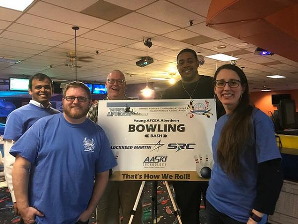 The team from Ad Hoc Research Associates strikes a pose at the March Bowling Bash, hosted by the chapter's Young AFCEANs.