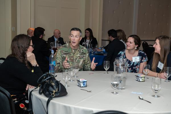 Maj. Gen. Randy Taylor, USA, commanding general of the U.S. Army Communications-Electronics Command, and senior commander for APG, speaks to a table of young women during a speed mentoring session at the February event.