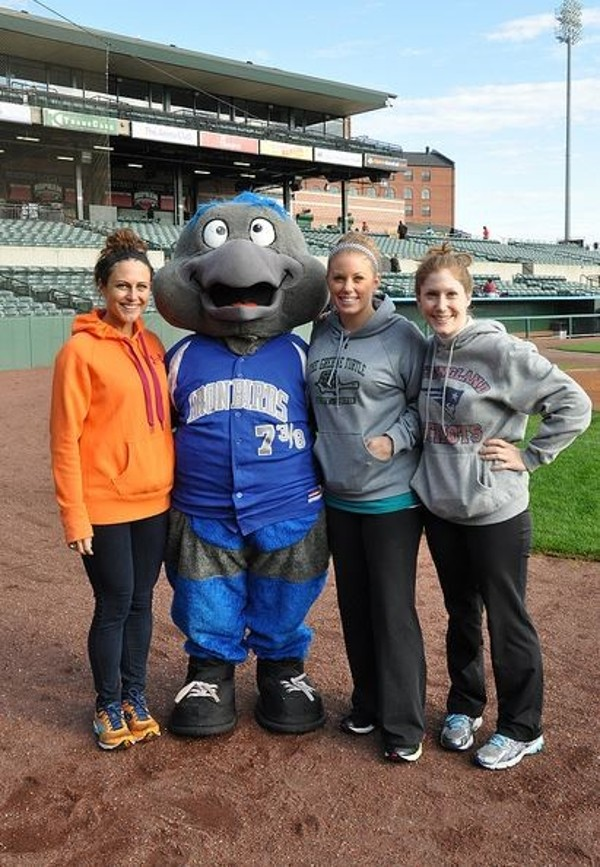In November, Young AFCEANs (l-r) Brittany Paulshock, Kristen Melamed and Maggie Quelet pose with the Ironbirds mascot.