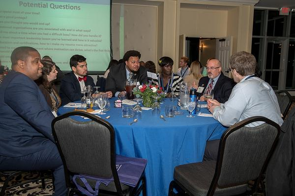 Martin (2nd from r) mentors a table of young professionals focusing on work life balance and professional development at the annual mentoring event in November.