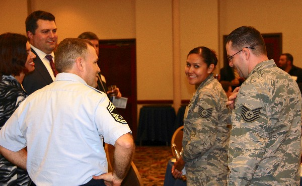 Tech Sgt. Rhyanna Benally, USAF (2nd from r), and Tech Sgt. Eric Garretson, USAF (far r), of the Air Force Intelligence, Surveillance and Reconnaissance Agency, chat with mentors and acquaintances at the chapter Young AFCEAN�s annual Mentor-Prot�g� Night in September.