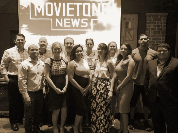 Attending the chapter's July screening of a documentary highlighting the women who programmed the first all-electronic computer are (back row, l-r) Dillon Watkins; Steven Russell; Rick Riney, Emily Rausch; Bethany Reese; Mark Robles; (front row, l-r) Kevin Weiss; Jennifer Bodin; Tiffany Tremont; Ryan Rosado; Natasha Martinez-Robles; and Jason Swint.