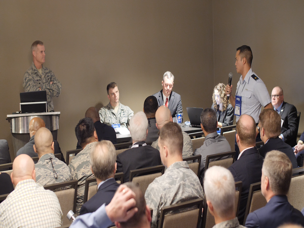 An attendee asks Col. Bill Waynick, USAF, a question during the Enterprise Information Technology as-a-Service (EITaaS) presentation at the chapter's annual conference, Alamo ACE, in November.