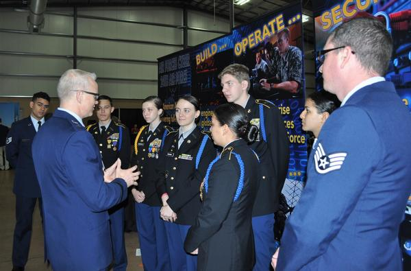 Maj. Gen. Christopher Weggeman, USAF, 24th Air Force commander, talks with one of the student teams at the San Antonio Mayor's Cyber Cup Awards Luncheon in March. The luncheon recognizes the area's top high school and middle school teams in the national CyberPatriot competition.