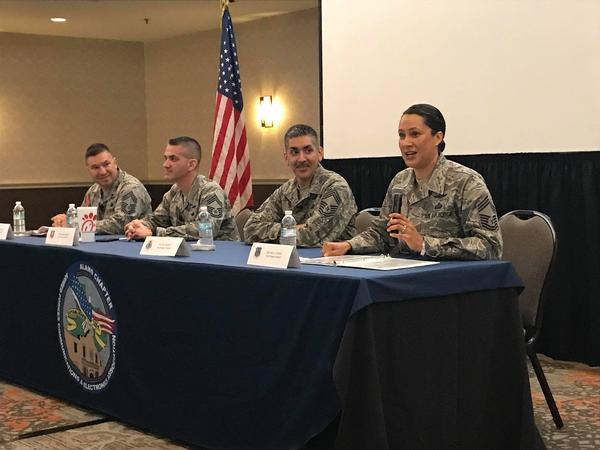 Chief Master Sgt. Michelle Stavig, USAF, moderates a first-of-its-kind panel of senior enlisted service members during the chapter's April luncheon. The other panelists are (l-r) Chief Master Sgt. Manuel Matute, USAF; Chief Master Sgt. Bryan Neumann, USAF; and Chief Master Sgt. Peter Franco, USAF.