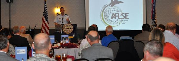 Col. Jeffrey Sorrell, USAF, deputy director of operations and communications, addresses chapter members and guests at the chapter's August luncheon.
