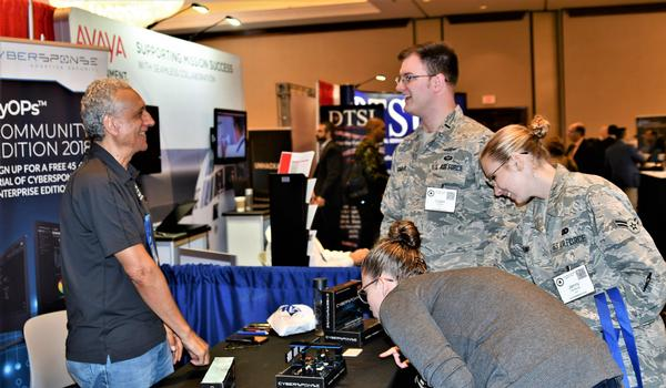 Military members and industry professionals network in the exhibit hall during the 2018 Alamo Chapter Event (ACE) in November.