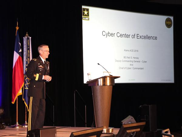 Brig. Gen. Neil Hersey, USA, commandant, U.S. Army Cyber School, addresses attendees during the chapter event in November.
