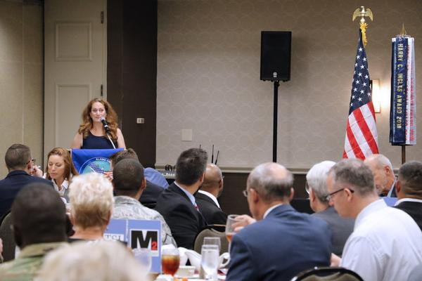 Erin Joe, director, Cyber Threat Intelligence Integration Center (CTIIC), discusses threat mitigation during the chapter's monthly luncheon in August.