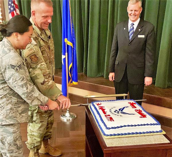 Maj. Gen. Timothy Lunderman, USAF, Air National Guard assistant to the commander, 24th Air Force and Air Forces Cyber, Joint Base San Antonio-Lackland, Texas, and Senior Airman Christine Parks, USAF,  ceremoniously cut the Air Force's 72nd birthday cake during the chapter's September luncheon.