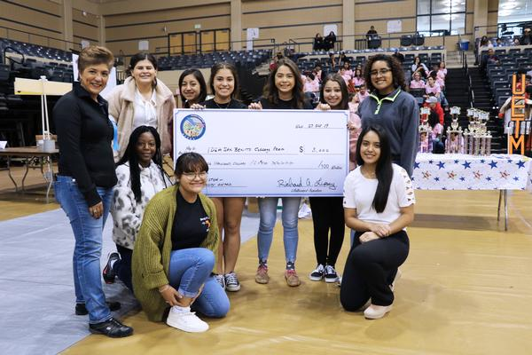 In October, members of the IDEA [Individuals Dedicated to Excellence and Achievement] Benito College Prep team pose with Karen Rolirad, chapter vice president of scholarships and educational grants, after receiving their $3,000 scholarship. The award was deemed the