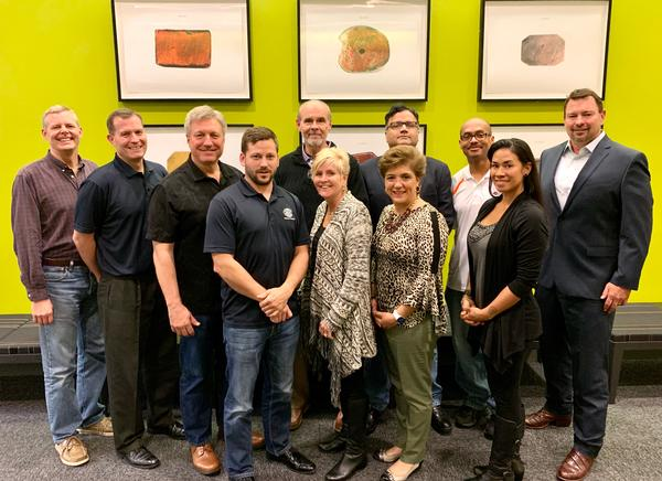 The chapter board of directors pose for a group photo after an in-person off-site in January to discuss 2020 initiatives.