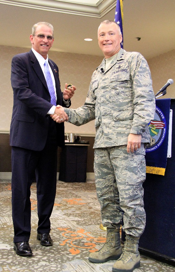 Maj. Gen. Kevin McLaughlin, USAF (r), commander, 24th Air Force, recognizes Ron Moore, Camber Corporations, as the company renews its chapter sponsorship for the sixth year in September.