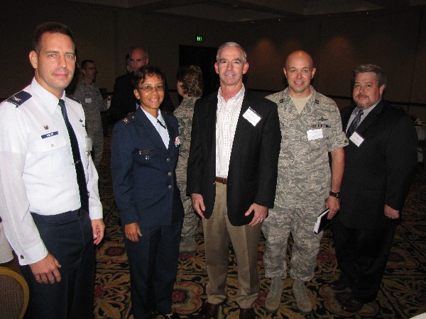 Joining together at the chapter�s Young AFCEAN networking event in October are (l-r) mentors Col. Paul Welch, USAF; Col. Lisa Tucker, USAF; and Gary McAlum, chief security officer, USAA; and prot�g�s Capt. Dave Sorrels, USAF; and Mike Bain.