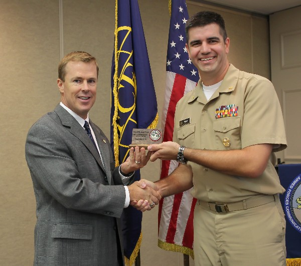 Lt. Cmdr. Michael Clay, USCG (r), director of Military Health System Cyberinfrastructure Services, receives a special thank you from Bill Morrow, chapter president, during the chapter�s September luncheon.