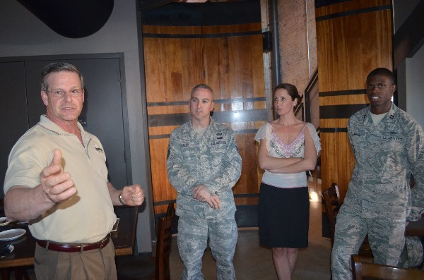 At a networking event in March, Al Lee (l), a capture manager for Abacus Technology, leads a discussion with attendees, including Young AFCEANs Master Sgt. Kelly Bales, USAF (2nd from l), Air Force Intelligence, Surveillance and Reconnaissance Agency (AFISRA); Emily Rausch, Young AFCEA adviser to the chapter board; and Capt. Sidney Harris, USAF, AFISRA.