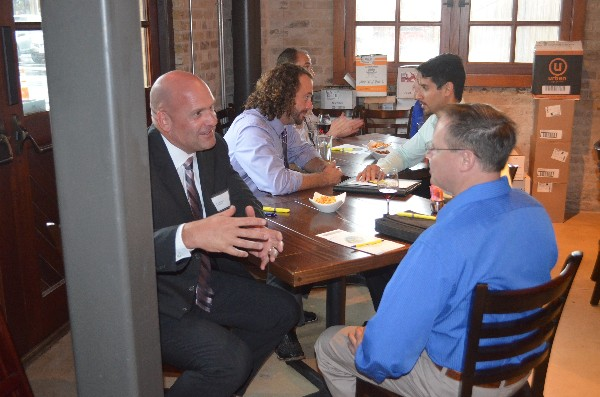 ALAMO—NAVMISSA's Peter Marks (front, l) counsels Aaron Homjak (r), as Trey Oats of SPAWAR (back, l) discusses career issues with Fernando Salamantes (r) at the Alamo Young AFCEANs Speed Mentoring event in June.