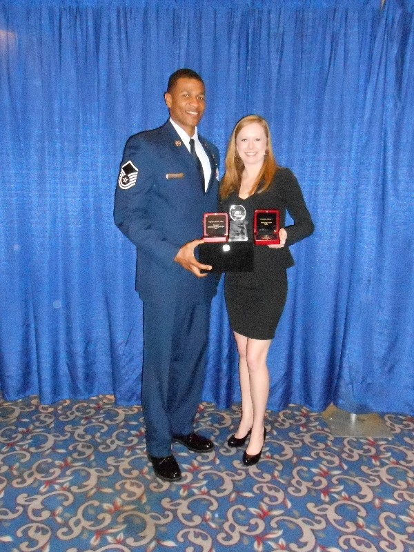 Master Sgt. Kiyon Buckley, USAF, 24th Air Force, Young AFCEAN of the Year, and Bethany Reese, Hilton San Antonio Airport, Emerging Leadership Award recipient, display their awards at the AFCEA West conference in January.