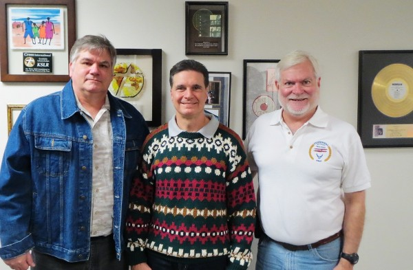 Military City USA Radio co-hosts Col. Kelley Crooks, USAF (Ret.) (l), and Mark Frye (r) pose with Brig. Gen. Sean Murphy, USAF, commander of the Air Force Medical Operations Agency, as they mark the show's 200th episode in December. The chapter sponsors Military City USA Radio.