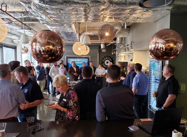 San Antonio and Austin locals gather with chapter board members during a social membership initiative at the Capitol Factory in Austin, Texas held in May.