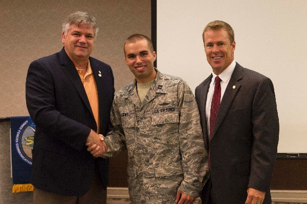 Morrow (r) and Kelley Crooks (l), regional vice president, express their sincere appreciation to Capt. Brian Higgins, USAF, for serving as chapter vice president of programs.