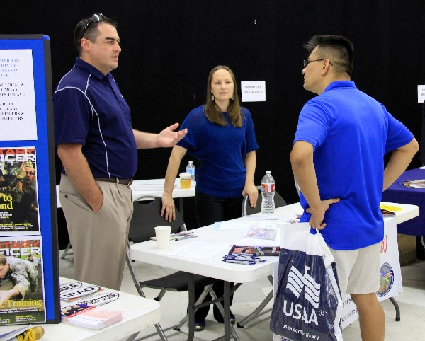 ALAMO—Young AFCEANs Brandon Gressett and Samantha Goggans explain the Alamo chapter's Way Ahead pilot program with a San Antonio veteran during the Got Your Six San Antonio Week kickoff event June 1.