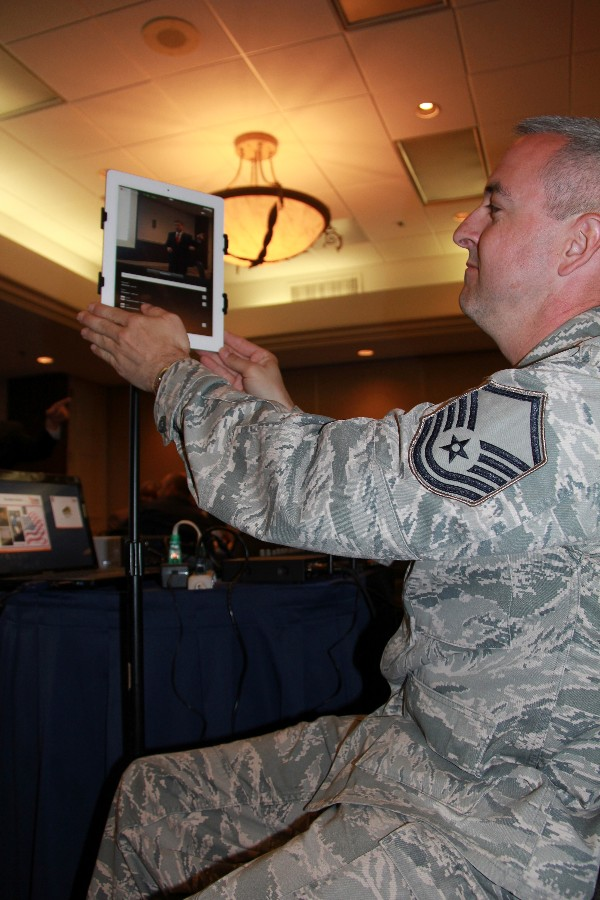 Master Sgt. Kelly Bales, USAF, adjusts an iPad used to broadcast and record the chapter's luncheon. Chapter events will be broadcast to sister chapters in Texas beginning in April.