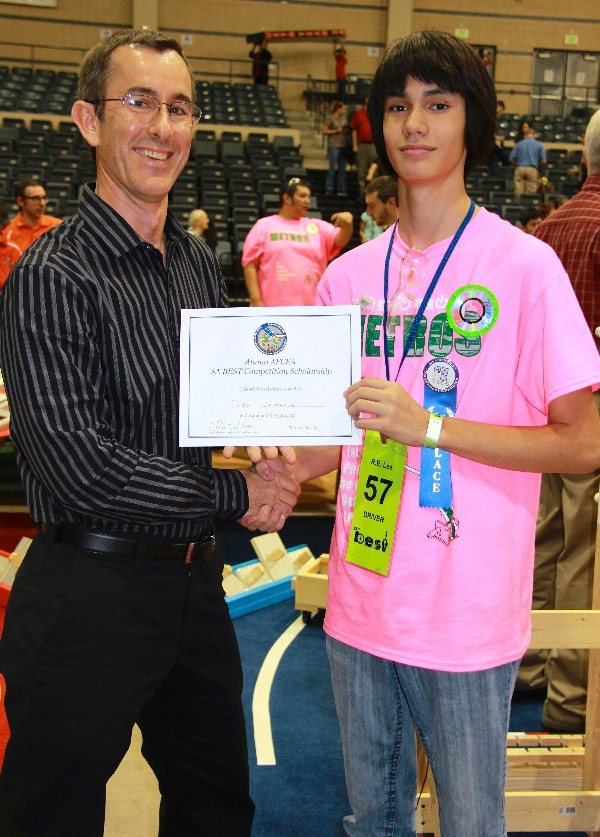 Clay Perce (l), the chapter's vice president of scholarships and educational grants, awards a $2,000 scholarship to Daniel Joaquin of Robert E. Lee High School, which took first place in the robotics competition portion of the state-qualifying round in November.