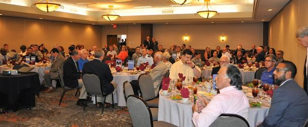 Chapter members and guests network and chat before guest speaker Col. Jeffrey Sorrell takes the floor at the August luncheon.