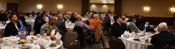 An attentive crowd listens to Cole's presentation at the chapter's luncheon in October.