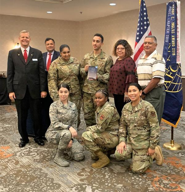 The Air Education and Training Command's Application Management Team accepts the Meritorious Rising Star for Achievement in IT Award during the chapter's October luncheon.