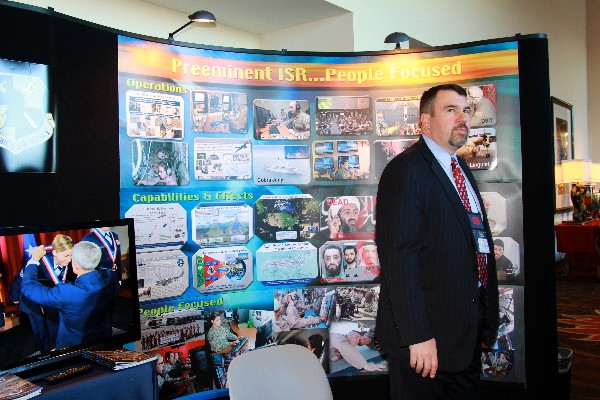 Todd Wilson mans the exhibit booth for the Air Force Intelligence, Surveillance and Reconnaissance Agency (AFISRA) during the December conference. The exhibit was a virtual exploration of the ISR mission, showing quiet intelligence gathering and targeting