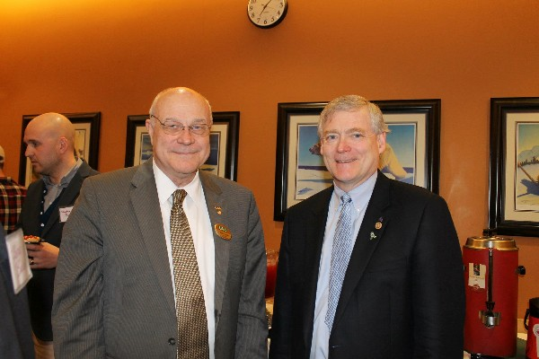 Alaska Lt. Gov. Mead Treadwell (r) joins together with Lt. Gen. Tom Case, USAF (Ret.), chancellor of the University of Alaska-Anchorage, during an event with the chapter in April.