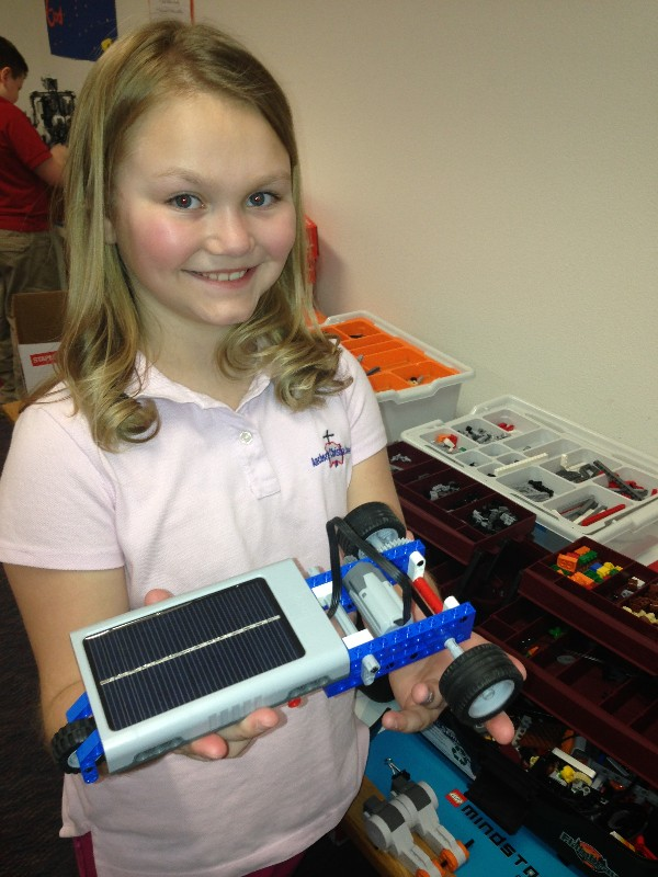 A student at Anchorage Christian School poses with her solar energy LEGO project in May, purchased with a grant from the chapter in partnership with its corporate sponsors.