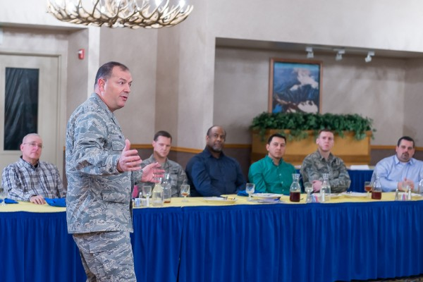 Col. Michael Finn II, USAF, senior communicator for Pacific Air Forces, delivers the keynote speech during the February meeting.