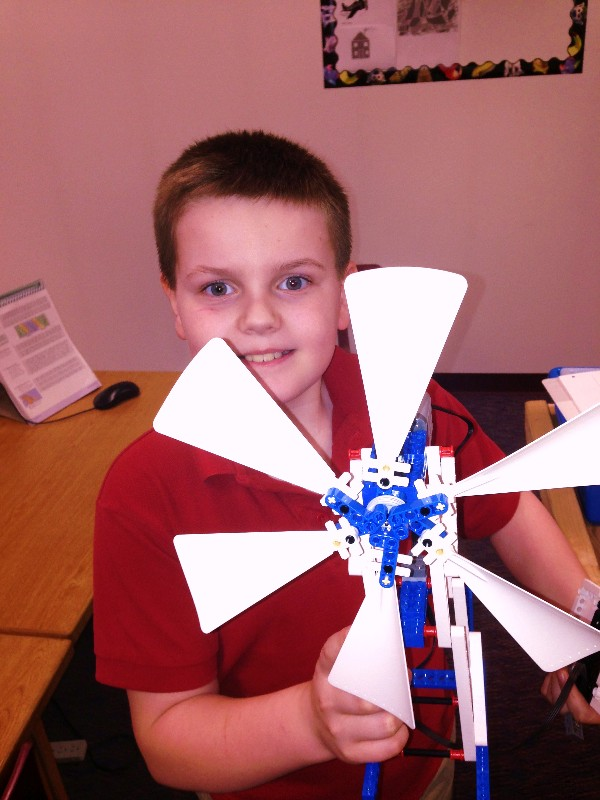 In May, a student at Anchorage Christian School poses with his wind energy LEGO project. The chapter awarded a $1,000 grant to the school to purchase LEGO Mindstorms kits.