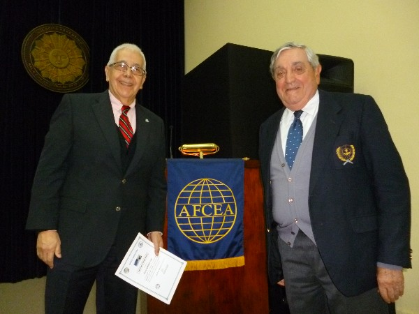 Professor Roberto Uzal, director of the Ph.D. in computer engineering at the National University of San Luis (l) receives a certificate of recognition from Rear Adm. Emilio Nigoul, ARA (Ret.), chapter president, in May.