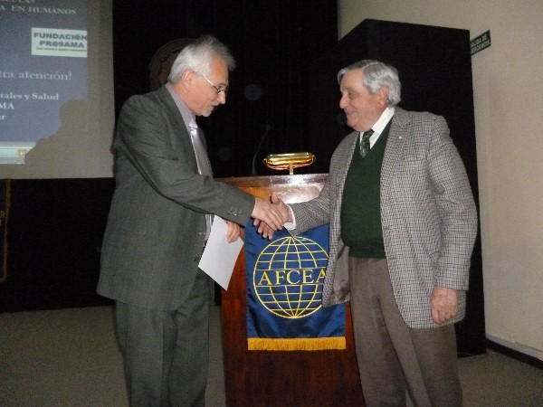 Rear Adm. Emilio Nigoul, ARA (Ret.), chapter president, presents a certificate of recognition to Jorge Herkovitz (l), Ph.D., at the October Nanotechnology Symposium.