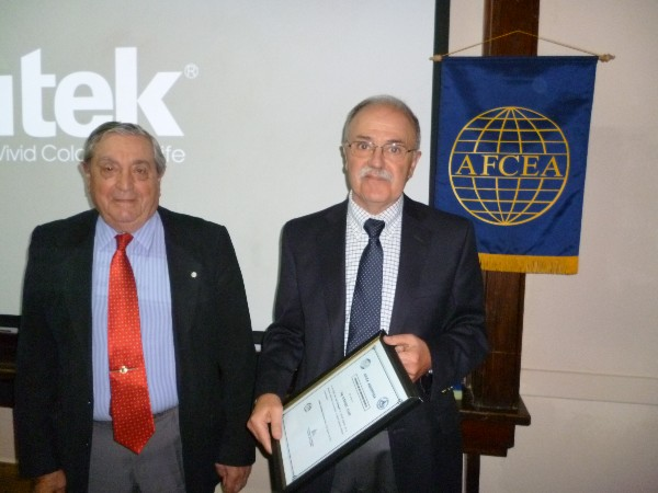 Daniel Lupi (r), president, Nanotechnology Argentina Foundation, receives a Distinguished Membership Award from Rear Adm. Emilio I. Nigoul, ARA (Ret.), chapter president, in August.