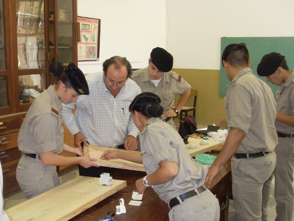 In June, Omar Difilippo, a professor at General Belgrano, works with cadets to install electrical boards, as part of a project funded by a Science Teaching Tools Award from the chapter.