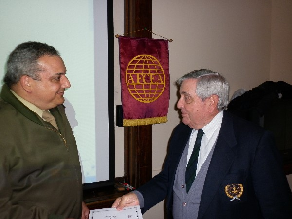 Lt. Col. Miguel Angel Blanco, EA (Ret.) (l), receives a certificate from Adm. Nigoul at the October symposium.