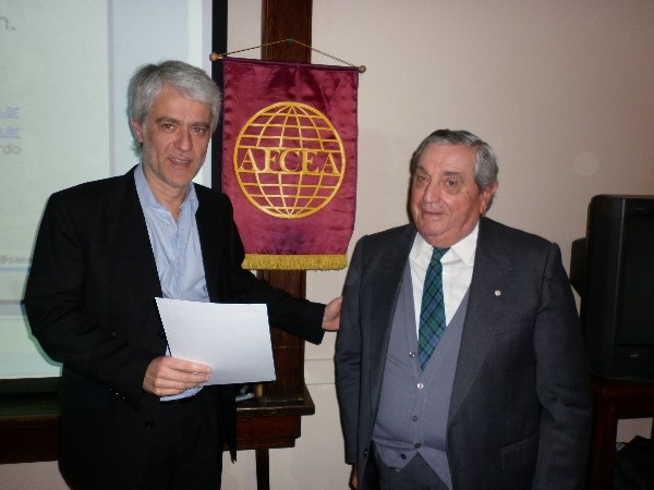 Ricardo Senz (l), Ph.D., receives a certificate of recognition from Adm. Nigoul in September.
