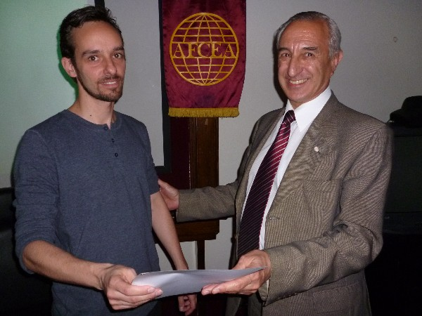 In November, Monticeli (l) receives a certificate of recognition from Luis Favotto, chapter board member and coordinator.