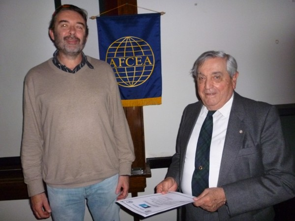 Juan Pablo Paz, Ph.D., senior researcher at the National Council of Scientific and Technical Research (l) receives a certificate of recognition from Rear Adm. Emilio Nigoul, ARA (Ret.), chapter president, at the conference in June.