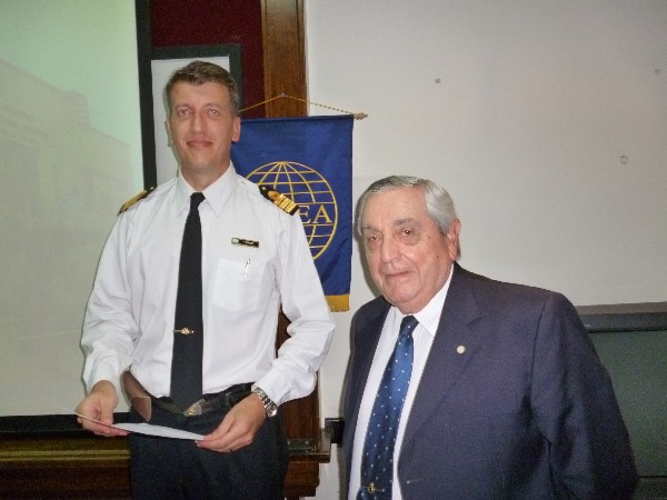 ARGENTINA—Rear Adm. Emilio Nigoul, ARA (Ret.) (r), chapter president, presents a certificate of recognition to Capt. Brosz in April.
