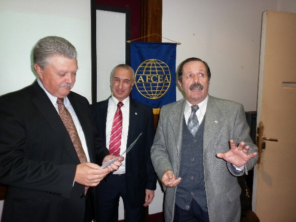 In August, Maj. Gen. Norberto Dimeglio, FAA (Ret.) (r), chapter first vice president, presents a certificate of recognition to Martino (l) while Luis Alberto Favotto, chapter board member, looks on.
