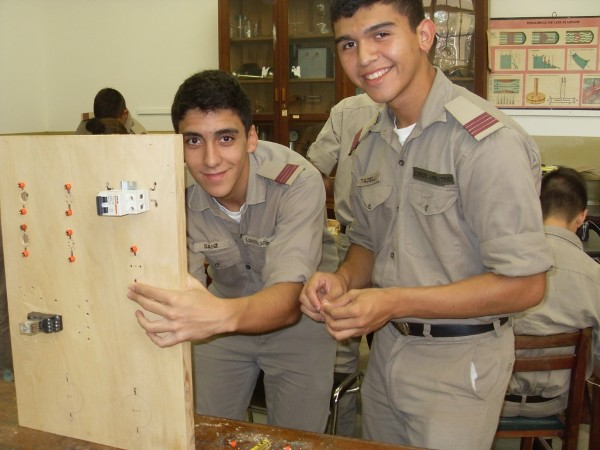 Cadets work on an electrical panel in June as part of a project funded by a chapter grant.