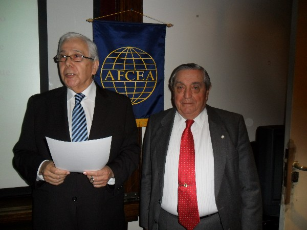 Uzal (l) receives a certificate of recognition from Rear Adm. Emilio Nigoul, ARA (Ret.), chapter president, following his speech at the June conference.