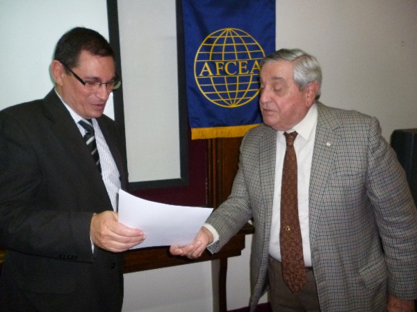 ARGENTINA�Rear Adm. Emilio Nigoul, ARA (Ret.) (right), chapter president, presents a certificate of recognition to Eng. Pesado in May.