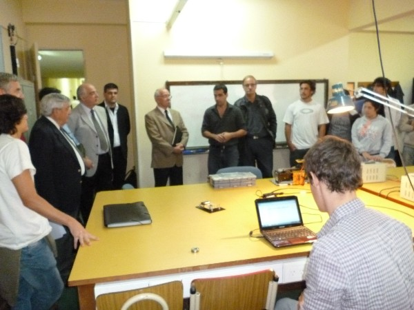 Members of the chapter board gather in March for a demonstration of the robotics lab at the Army University.